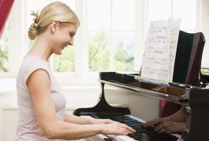 Woman playing music with self confidence